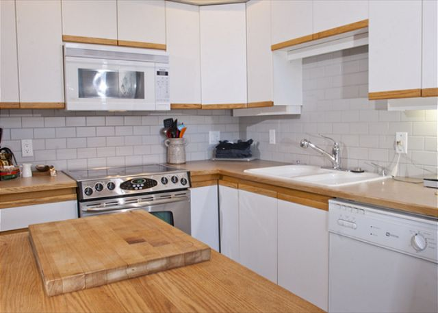 The renovated kitchen has heated slate floors and is stocked for serious cooking.