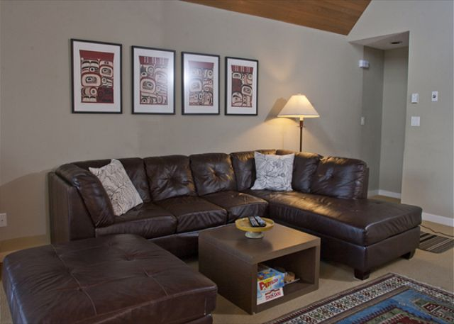 The living area has a flat screen TV and feature fireplace.